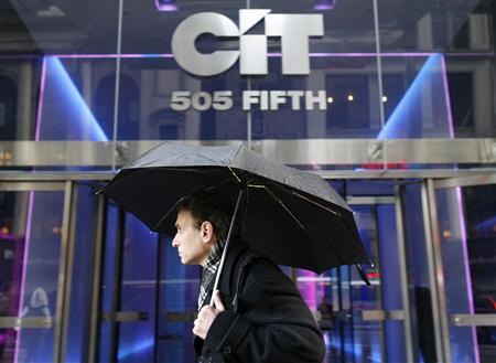 A morning commuter walks past the CIT Group Inc. building in New York, in this November 2, 2009, file photo. REUTERS/Brendan McDermid/Files