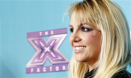 Judge Britney Spears poses at the party for the television series ''The X Factor'' finalists in Los Angeles, California November 5, 2012. REUTERS/Mario Anzuoni