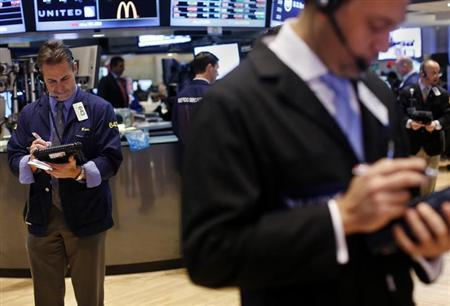Traders work on the floor of the New York Stock Exchange, February 6, 2013. REUTERS/Shannon Stapleton