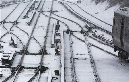 A Long Island Railroad train is seen on snowy tracks in Port Washington, New York February 8, 2013. The northeastern United States braced on Friday morning for a blizzard that could drop up to three feet (nearly one meter) of snow through Saturday and bring travel to a halt. REUTERS/Shannon Stapleton