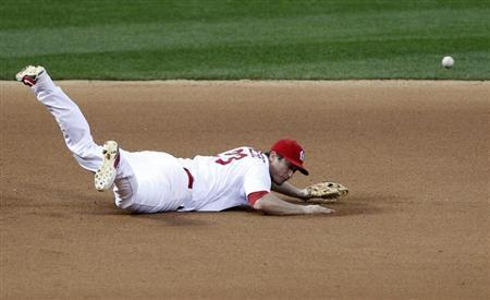 St. Louis Cardinals third baseman David Freese is unable to reach a single by San Francisco Giants' Buster Posey in the seventh inning during Game 3 of their MLB NLCS playoff baseball series in St. Louis, Missouri, October 17, 2012. REUTERS/Sarah Conard