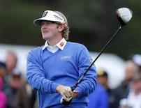 Golfer Brandt Snedeker watches his drive off the 10th tee of the south course at Torrey Pines during first round play at the Farmers Insurance Open in San Diego, California January 24, 2013. REUTERS/Mike Blake