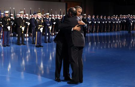 President Barack Obama hugs Defense Secretary Leon Panetta during the Armed Forces Farewell Tribute to Panetta at Joint Base Myer-Henderson in Washington February 8, 2013. REUTERS/Kevin Lamarque