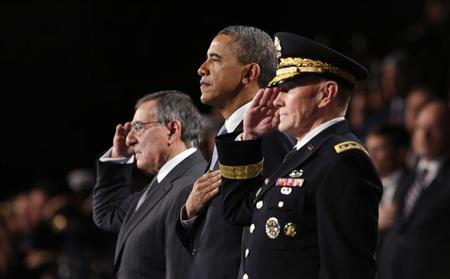 U.S. President Barack Obama attends the Armed Forces Farewell Tribute in honor of Defense Secretary Leon Panetta (L) at Joint Base Myer-Henderson in Washington February 8, 2013. REUTERS/Kevin Lamarque