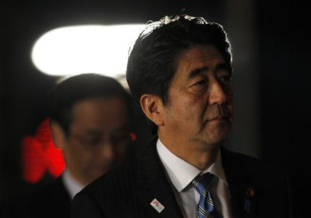 Japan's Prime Minister Shinzo Abe (R) arrives at his official residence for attending an advisory panel on restructuring legal infrastructure of security guarantees in Tokyo February 8, 2013. REUTERS/Issei Kato