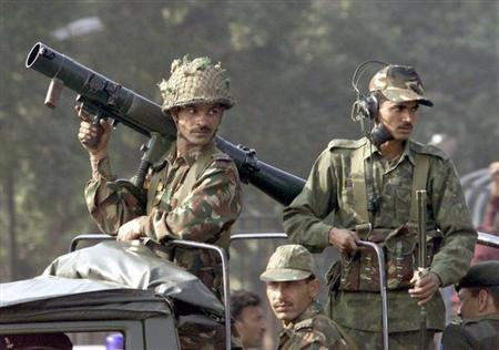 Heavily-armed soldiers patrol near the Indian parliament in New Delhi December 13, 2001. REUTERS/Kamal Kishore/Files