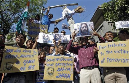 Demonstrators carry placards and posters and an effigy depicting Mohammad Afzal Guru during celebrations in Ahmedabad February 9, 2013. REUTERS/Amit Dave