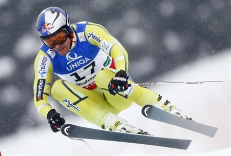 Aksel Lund Svindal of Norway skis during the men's Downhill race at the World Alpine Skiing Championships in Schladming February 9, 2013. REUTERS/Dominic Ebenbichler