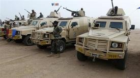 Chadian soldiers form a line with their armoured vehicles in the northeastern town of Kidal, Mali, February 7, 2013. Around 1,000 troops from Chad led by the president's son advanced towards the mountains of northeast Mali on Thursday to join French search-and-destroy operations hunting Islamist jihadists. Picture taken February 7, 2013. REUTERS/Cheick Diouara