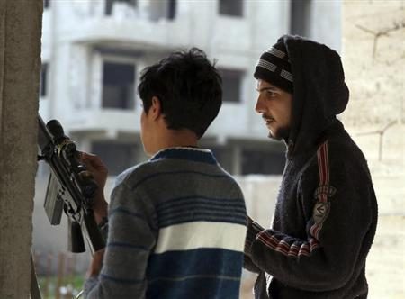 Free Syrian Army fighters calibrate the scope of a rifle in the Ain Tarma neighbourhood of Damascus February 7, 2013. REUTERS/Mohammed Abdullah