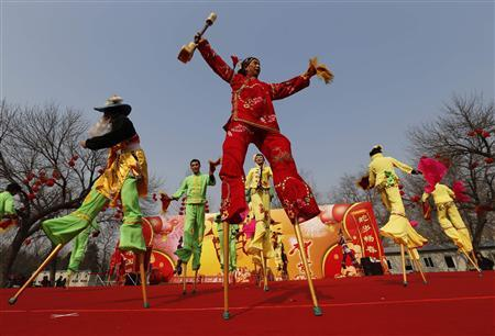 Folk artists perform on stilts at Longtan Park in Beijing February 9, 2013. REUTERS/Kim Kyung-Hoon
