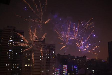Fireworks light up the skyline of Beijing as residents celebrate the start of the Chinese New Year February 9, 2013. The Lunar New Year, or Spring Festival, begins on February 10 and marks the start of the Year of the Snake, according to the Chinese zodiac. REUTERS/Petar Kujundzic
