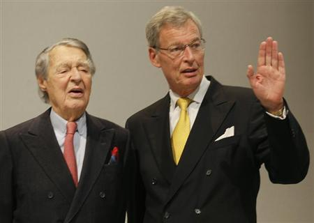 Gerhard Cromme, chairman of the supervisory board of German steelmaker ThyssenKrupp AG, gestures as he stands on the podium with Berthold Beitz, 99-year-old chairman of the Alfried Krupp von Bohlen and Halbach Foundation, before the company's annual shareholders meeting in Bochum January 18, 2013. REUTERS/Wolfgang Rattay