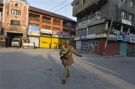An Indian policeman patrols a deserted road during restriction in Srinagar February 9, 2013. India has executed a Kashmiri militant who was sentenced to death 10 years ago for an attack on the Indian parliament in 2001, a senior interior ministry official said on Saturday. The country's president rejected a mercy petition from Mohammad Afzal Guru and he was hung at dawn, TV channels said. Strict restrictions on people's movements was imposed in major towns of Indian Kashmir early on Saturday in anticipation of protests against the hanging. REUTERS/Danish Ismail