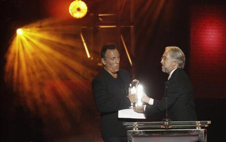 President of the National Academy of Recording Arts and Sciences Neil R. Portnow presents Bruce Springsteen with the 2013 MusiCares Person of the Year award at a gala in Los Angeles, California February 9, 2013. REUTERS/Mario Anzuoni