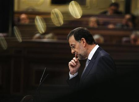 Spain's Prime Minister Mariano Rajoy gestures during a parliamentary session in Madrid, July 11, 2012. REUTERS/Andrea Comas