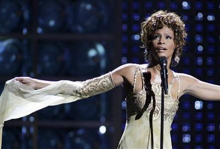 Whitney Houston performs during the World Music Awards as a tribute to music mogul Clive Davis, who received the Outstanding Contribution to the Music Industry Award, at the Thomas & Mack Center in Las Vegas, Nevada in this September 15, 2004 file photo. Houston died February 11, 2012 of accidental drowning due to the ''effects'' of heart disease and cocaine use, according to the official autopsy report. REUTERS/Ethan Miller/Files