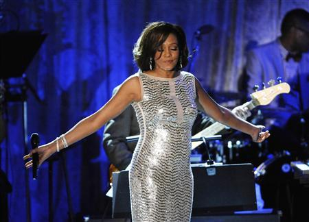 Whitney Houston performs at the Pre-Grammy Gala & Salute to Industry Icons with Clive Davis honoring David Geffen held in Beverly Hills, California, in this February 12, 2011, file photo. Houston died February 11, 2012 of accidental drowning due to the ''effects'' of heart disease and cocaine use, according to the official autopsy report. REUTERS/Phil McCarten/Files