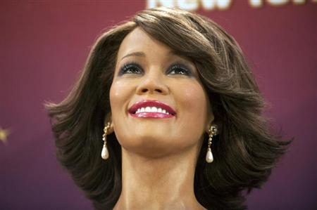 One of four wax figures of deceased singer Whitney Houston sits on display after being unveiled at Madame Tussauds Wax Museum in New York, February 7, 2013. REUTERS/Keith Bedford