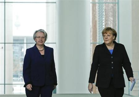 German Chancellor Angela Merkel (R) and Education Minister Annette Schavan arrive for a statement to the media in Berlin February 9, 2013. REUTERS/Tobias Schwarz