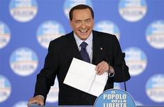 Former Italian prime minister Silvio Berlusconi smiles during a political rally in downtown Rome, February 7, 2013. REUTERS/Max Rossi