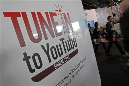 Visitors walk past a YouTube stand during the International Record Music Publishing and Video Music Market (MIDEM) in Cannes January 27, 2013. REUTERS/Jean-Paul Pelissier