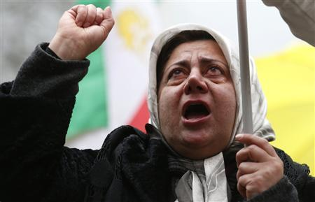 A supporter of the People's Mojahedin Organization Of Iran (PMOI) cries as she demonstrates outside the U.S. Embassy in London February 9, 2013. REUTERS/Suzanne Plunkett