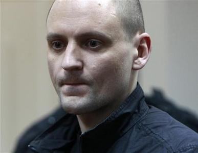 Opposition leader Sergei Udaltsov reacts to the the court's decision during a hearing in Moscow February 9, 2013. Russia's top investigative agency said on Friday it was seeking to put Udaltsov under house arrest charged with plotting mass disorder in protests against President Vladimir Putin. REUTERS/Maxim Shemetov