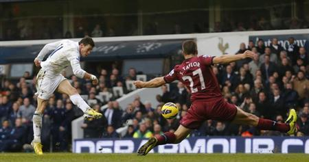 Gareth Bale of Tottenham Hotspur takes a shot at goal as Newcastle United's Steven Taylor stretches to block during their English Premier League soccer match at White Hart Lane in London, February 9, 2013. REUTERS/Andrew Winning
