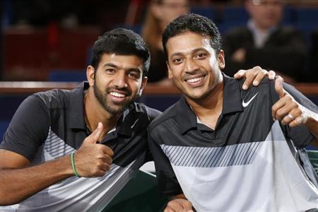 Mahesh Bhupathi (R) and Rohan Bopanna pose as they celebrate after winning their men's doubles final match against Aisam-Ul-Haq Qureshi of Pakistan and Jean-Julien Rojer of the Netherlands at the Paris Masters tennis tournament November 4, 2012. REUTERS/Cedric Lecocq /Files