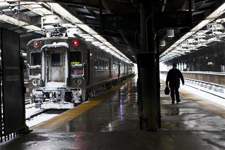 A NJ transit worker arrives to Hoboken station after the passing of a winter storm in Hoboken, New Jersey, February 9, 2013. REUTERS/Eduardo Munoz