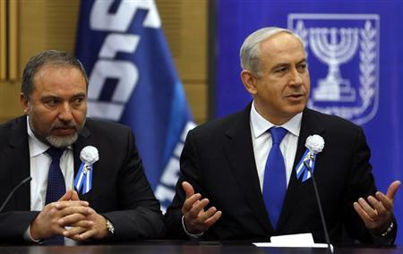 Israel's Prime Minister Benjamin Netanyahu (R) and former foreign minister Avigdor Lieberman attend a Likud-Beitenu faction meeting at parliament in Jerusalem February 5, 2013. REUTERS/Baz Ratner