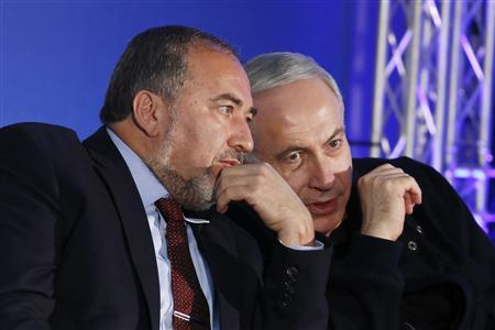 Israel's Prime Minister Benjamin Netanyahu (R) converses with former Foreign Minister Avigdor Lieberman during a Likud-Yisrael Beitenu campaign rally in the southern city of Ashdod January 16, 2013. REUTERS/Amir Cohen