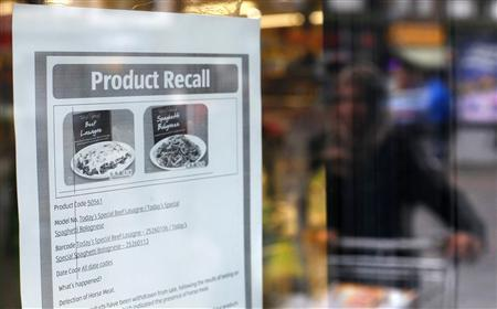 A customer enters an Aldi supermarket displaying a recall sign for products where horsemeat was detected, in northwest London February 9, 2013. The French government promised on Saturday to punish those found responsible for selling horsemeat in beef products at the heart of a growing scandal that started in Britain but is quickly spreading to France. REUTERS/Suzanne Plunkett (BRITAIN - Tags: FOOD POLITICS BUSINESS AGRICULTURE ANIMALS)