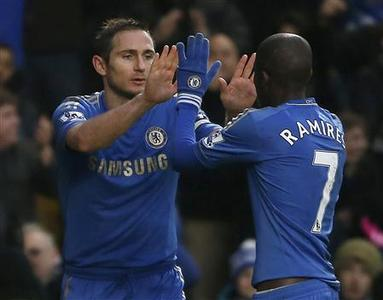 Chelsea's Frank Lampard (L) celebrates his goal against Wigan Athletic wth Ramires during their English Premier League soccer match at Stamford Bridge in London February 9, 2013. REUTERS/Eddie Keogh