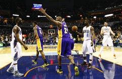 Los Angeles Lakers shooting guard Kobe Bryant (24) reacts after a play against the Charlotte Bobcats during the second half of their NBA basketball game in Charlotte, North Carolina February 8, 2013. REUTERS/Chris Keane