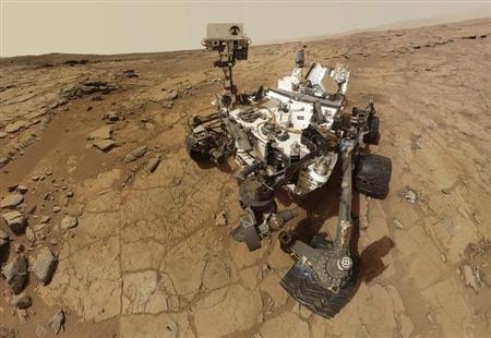 NASA's Mars rover Curiosity is pictured in this February 3, 2013 handout self-portrait obtained by Reuters February 9, 2013. REUTERS/NASA/Handout.