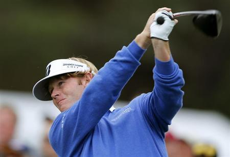U.S. golfer Brandt Snedeker hits a driver off the 10th tee of the south course at Torrey Pines during first round play at the Farmers Insurance Open in San Diego, California January 24, 2013. REUTERS/Mike Blake