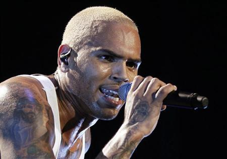 Singer Chris Brown performs in concert during the F.A.M.E. Tour in Los Angeles October 20, 2011. REUTERS/Danny Moloshok