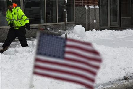 A man shovels the sidewalk after the pass of a winter storm in Hoboken in New Jersey, February 9, 2013. REUTERS/Eduardo Munoz