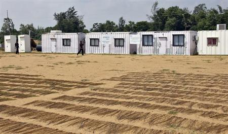 Private security guards walks at the Posco India Odisha Project site office at Nuagaoan panchayat in Kujanga block in Jagatsingpur district of Odisha October 12, 2012. REUTERS/Stringer/Files