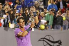 Spain's Rafael Nadal gestures after winning his men's singles match against France's Jeremy Chardy at the Chilean Open tennis tournament in Vina del Mar city February 9, 2013. /Photo prise le 9 février 2013/REUTERS/Eliseo Fernandez