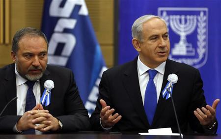 Israel's Prime Minister Benjamin Netanyahu (R) and former foreign minister Avigdor Lieberman attend a Likud-Beitenu faction meeting at parliament in Jerusalem February 5, 2013. REUTERS/Baz Ratner (JERUSALEM - Tags: POLITICS)