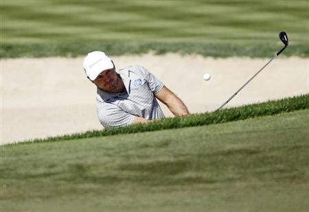 Richard Sterne of South Africa hits out of a bunker at the third green during the fourth and final round of the Dubai Desert Classic at the Emirates Golf Club February 3, 2013. REUTERS/Jumana El Heloueh