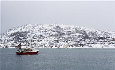 A fishing boat returns from a trip to the Barents Sea to the tiny port of Sommaroya, north Norway January 31, 2013. Cod quotas off north Norway are at a record high despite a crisis for world fish stocks. Picture taken January 31, 2013. REUTERS/Alister Doyle