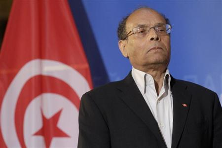 Tunisia's President Moncef Marzouki listens his national anthem at the European Parliament in Strasbourg, February 6, 2013. REUTERS/Jean-Marc Loos