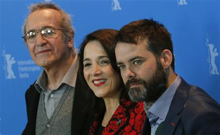 Director Sebastian Lelio (R-L), actress Paulina Garcia and actor Sergio Hernandez pose during a photocall to promote the movie ''Gloria'' at the 63rd Berlinale International Film Festival in Berlin February 10, 2013. REUTERS/Tobias Schwarz