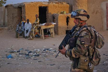 A French soldier patrols in the northern city of Gao, Mali February 9, 2013. REUTERS/Francois Rihouay