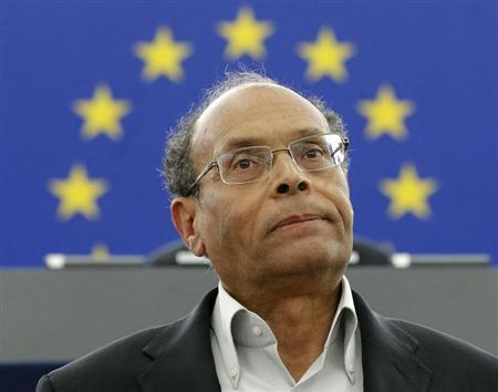 Tunisia's President Moncef Marzouki reacts as he delivers his speech at the European Parliament in Strasbourg, February 6, 2013. REUTERS/Christian Hartmann