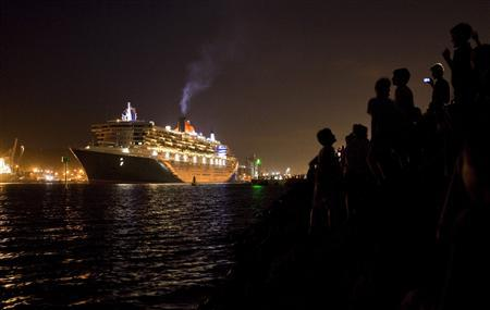 People line the shore as the Queen Mary 2 leaves Durban harbour in this March 23, 2010 file photo. Posted between septuagenarian passengers in deck chairs, lookouts stand watch over the Gulf of Aden, scanning the horizon for pirates. After more than half a decade of Somali men attacking Indian Ocean shipping from small speedboats with AK-47s, grappling hooks and ladders, the number of attacks is falling fast.The last merchant ship to be successfully hijacked, naval officers monitoring piracy say, was at least nine months ago. It's a far cry from the height of the piracy epidemic two years ago, when several ships might be taken in a single week to be traded for airdropped multi-million dollar ransoms. REUTERS/Rogan Ward/files